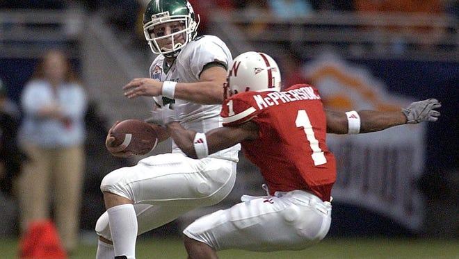 Former MSU quarterback Jeff Smoker tries to elude Nebraska's Lornell McPherson in the 2003 Alamo Bowl. MSU lost, 17-3.