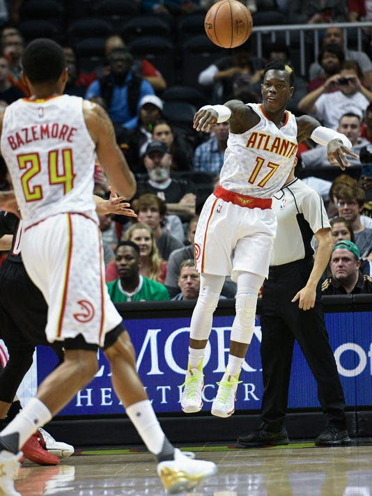 Atlanta Hawks guard Dennis Schroder (17) passes to forward Kent Bazemore (24) during the first half of an NBA basketball game against the Portland Trail Blazers, Saturday, March 18, 2017, in Atlanta. (AP Photo/John Amis)