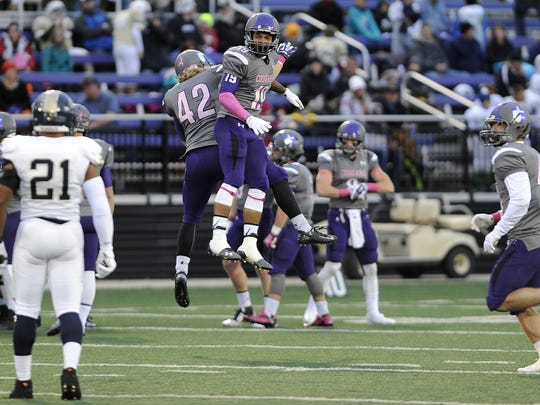 USF's Jess Williams and Solomon St. Pierre celebrate during a game against Concordia University at Bob Young Field in 2014. Williams, who played for Wall, took it upon himself to get noticed by area colleges
