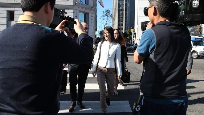 Ellen Pao (C) leaves the San Francisco Superior Court Civic Center Courthouse on March 27, 2015 in San Francisco, Calif.