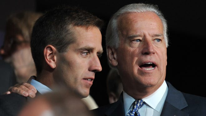 This Aug. 25, 2008, file photo shows then- Democratic vice presidential nominee Joe Biden and his son Beau at the Democratic National Convention in Denver.