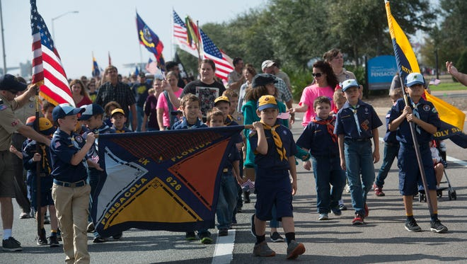 Active duty and former military personnel, youth organizations, and other groups show their support for the nations veterans during the annual Veterans Day parade in downtown Pensacola Wednesday morning.