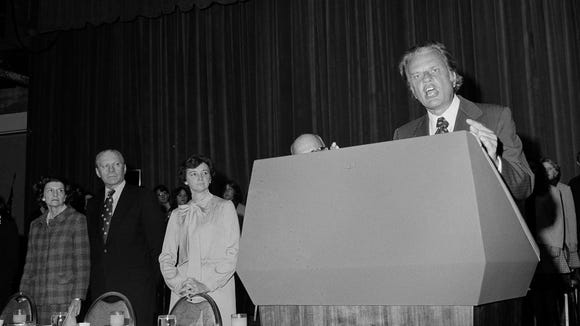 President Ford and First Lady Betty Ford, left, listen