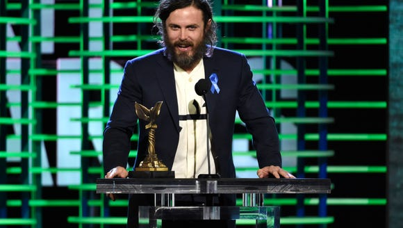 Casey Affleck accepts the award for best male lead