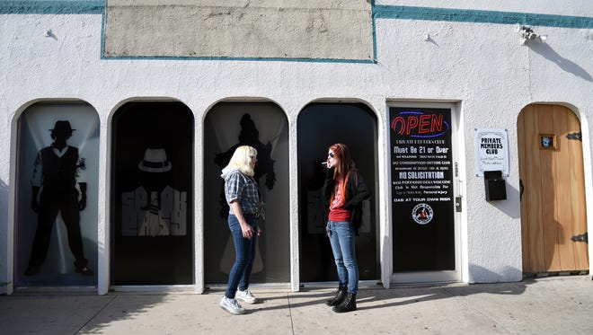 Linda Wood, left, and Megan Ballance, smoke cigarettes outside of the Speakeasy Vape Lounge, one of the United States' only legal pot clubs, in Colorado Springs, Colo., on April 12. Speakeasy has been open since 2013.