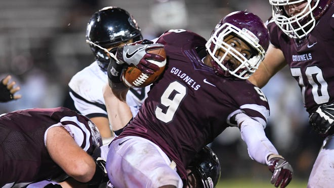 Henderson County running back Dada Simpson carries the ball against Muhlenberg County last season at Colonel Stadium.