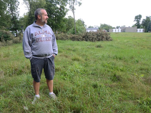 Rev. Scott Bouldrey, pastor of Christ United Methodist Church and co-pastor of First United Methodist Church, looks to the 5.5 acres owned by Washington Heights United Methodist Church which may be turned into an urban farm producing a variety of fruits and vegetables.