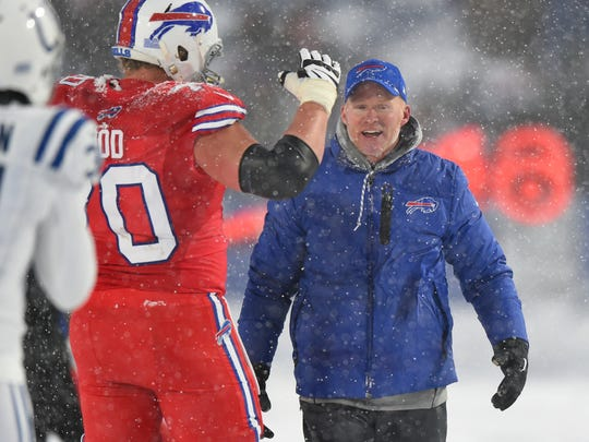 Dec 10, 2017; Orchard Park, NY, USA; Buffalo Bills head coach Sean McDermott celebrates on the field with center Eric Wood (70) following their overtime win against the Indianapolis Colts at New Era Field. Mandatory Credit: Rich Barnes-USA TODAY Sports