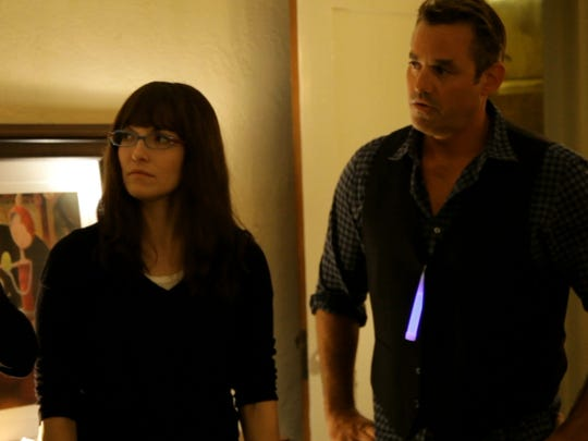"Elizabeth Gracen (left to right), Lorene Scafaria and Nicholas Brendon in a scene from ""Coherence."""