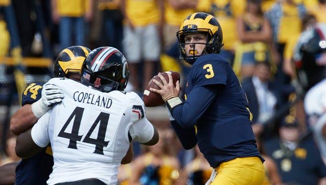 Sep 9, 2017; Ann Arbor, MI, USA; Michigan Wolverines quarterback Wilton Speight passes in the first half against the Cincinnati Bearcats at Michigan Stadium.