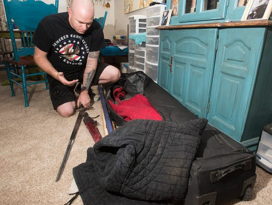 Air Force Staff Sgt. Micah Nelson packs up his weapons