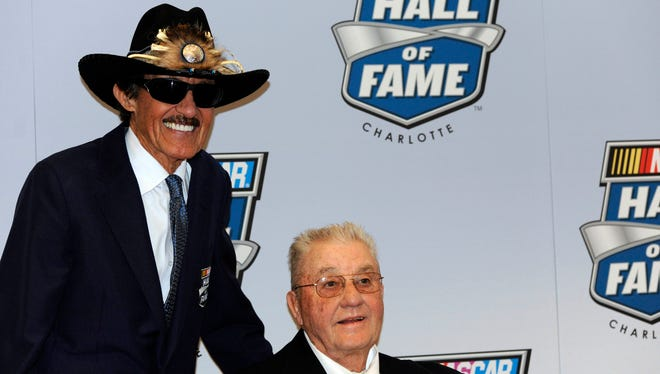 Maurice Petty, right, joined four other inductees into NASCAR's Hall of Fame on Wednesday. His brother Richard, left, was inducted in 2010.
