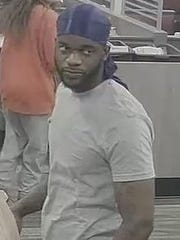Police are looking for this man, suspected of passing a counterfeit bill.