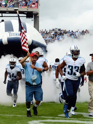 Tennessee Titans safety Michael Griffin (33) and teammates enter the field for an NFL football game against the Indianapolis Colts on Sept. 27