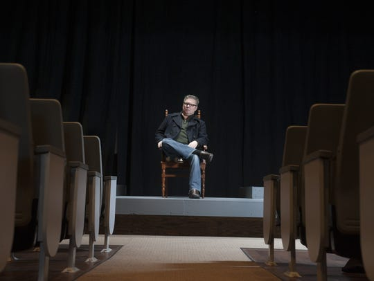 Joe Paprzycki sits onstage at South Camden Theatre in 2014. He left the theater in 2016.