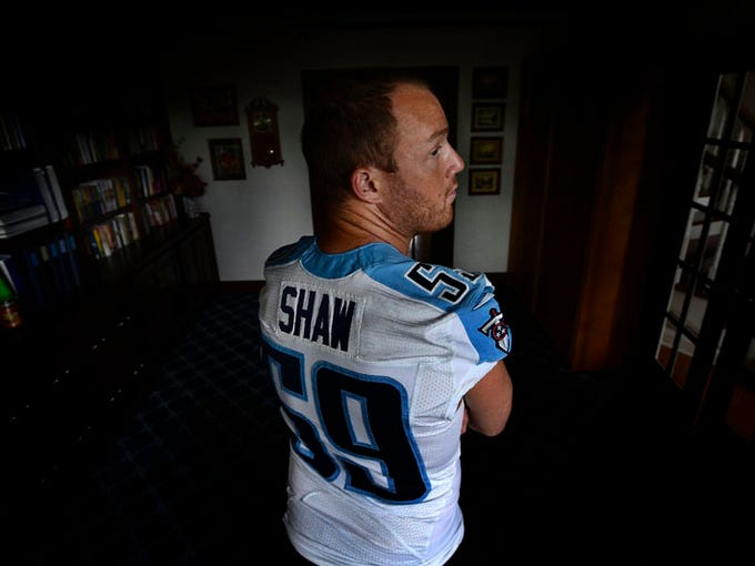 Tim Shaw wears his jersey from the Tennessee Titans