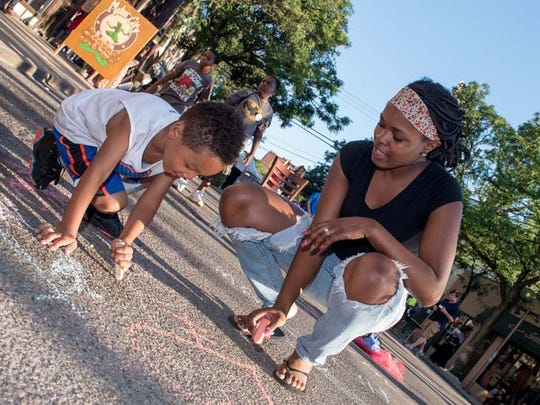 The annual Sidewalk Festival of Performing Arts filled Brightmoor's Detroit Artist's Village on Saturday, Aug. 1, 2015. The event hosted nearly 100 artists, street performers, musicians and theater performers.