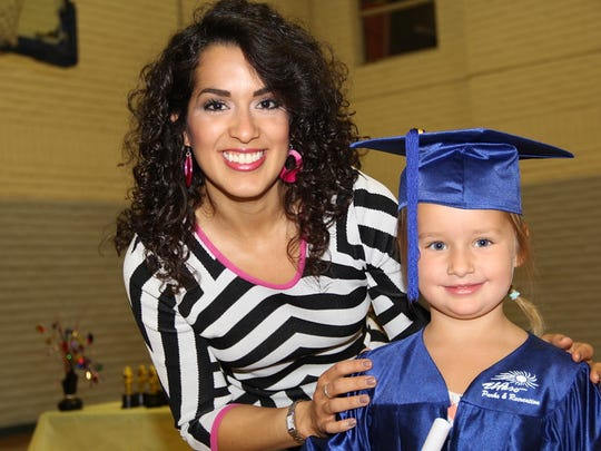 Stephanie Valle, left, is shown with Lilyana Grace Pavlat.