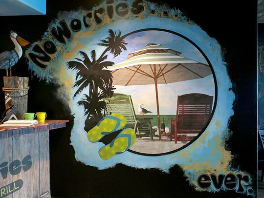 Walls are seen decorated with beach-like murals, Monday,