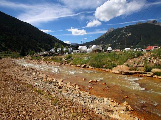 Cement Creek flows towards the Animas River, Monday, Aug. 10, 2015, through Silverton, Colorado, following the Gold King Mine spill.