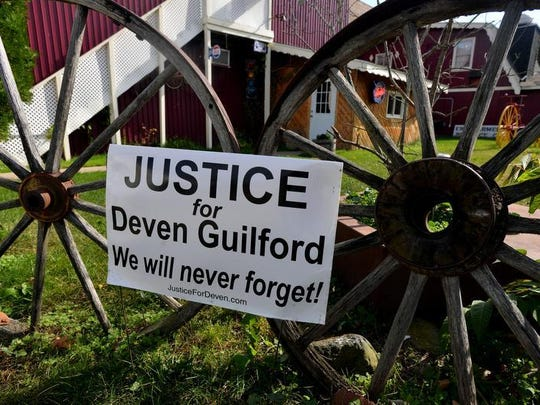"""A """"Justice for Deven Guilford"""" sign in his hometown of Mulliken Monday. Deven Guilford, 17, died after a traffic stop and confrontation with an Eaton County Sheriff's sergeant on M-43 between Grand Ledge and Mulliken in February."""