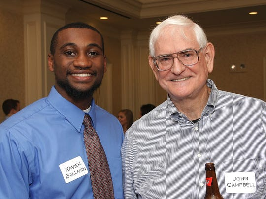UAB-Montgomery Medical student Xavier Baldwin, left,