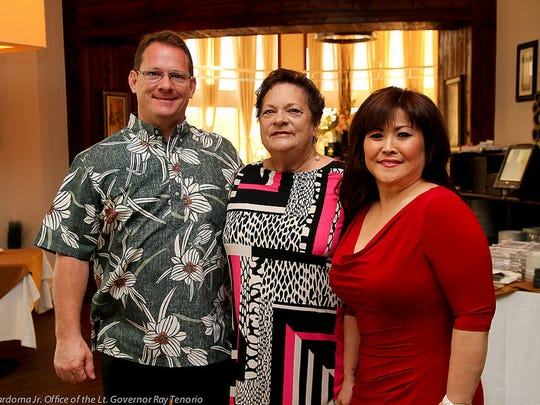 In this file photo, Lt. Gov. Ray Tenorio, left, is shown with his mother, Helen Tenorio, and his wife, Naoko Shimizu.