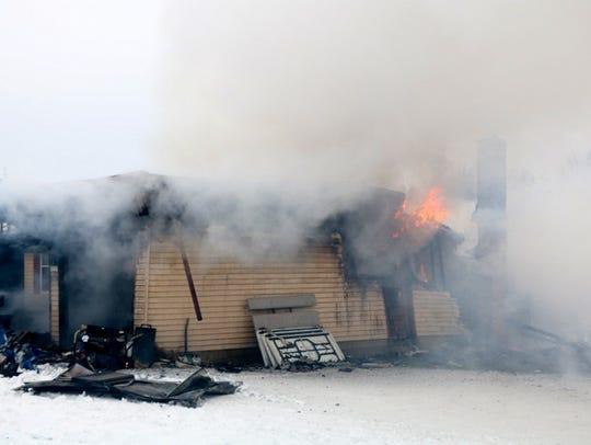 Mifflin Township firefighters battle a fire on Township
