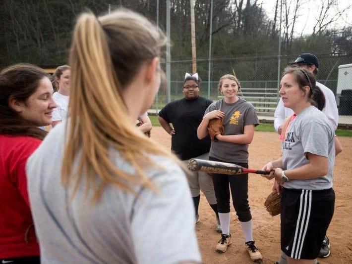 Tuscola softball coach Tara Gibbs talks to her players during Thursday's practice in Waynesville.