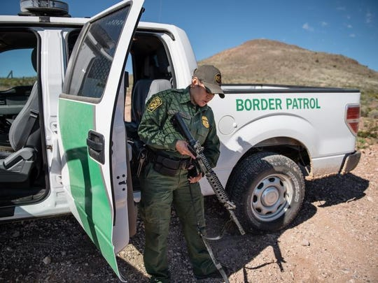 In this Aug. 30, 2016 photo, Lorena Apodaca prepares her weapon prior to patrolling an area along the fence that makes up the U.S-Mexico border near the boot heel section in southern New Mexico.