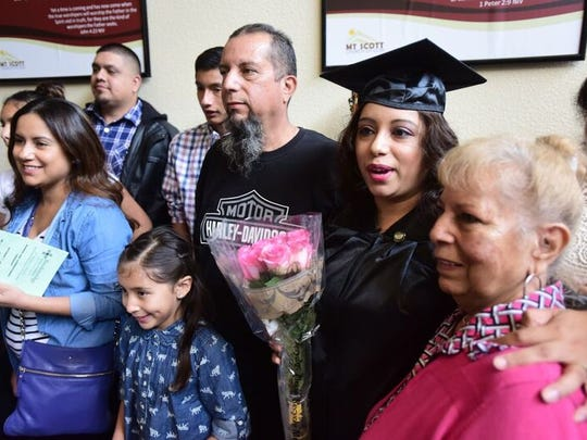 Chantel Marqez is surrounded by family at a graduation ceremony on Saturday, Oct. 1, 2016, for ITT Technical Institute's Breckinridge School of Nursing School at Mt. Scott Church of God in Portland. Marquez finished her associate's degree in nursing just before ITT Tech shut down operations.