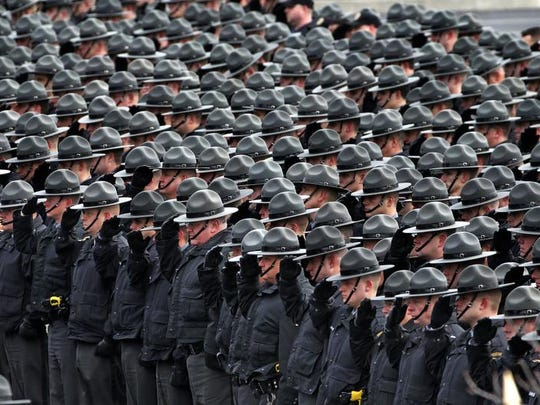 Pennsylvania State Troopers line up outside the Blair