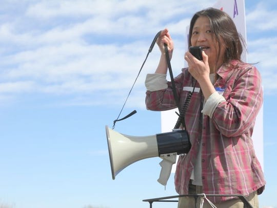 Josey Foo tells her story of once being an undocumented immigrant during a March 4 rally on the grounds at the Farmington Museum at Gateway Park.