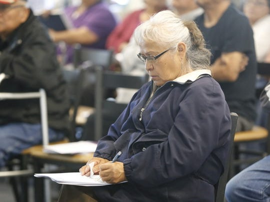 Thoreau resident Ella House takes notes during a presentation about traditional Navajo funerary practices on Tuesday at Navajo Technical University in Crownpoint.