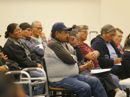 Coyote Canyon resident Franklin Tso, center, listens to a presentation about traditional Navajo burial procedures on Tuesday at Navajo Technical University in Crownpoint.
