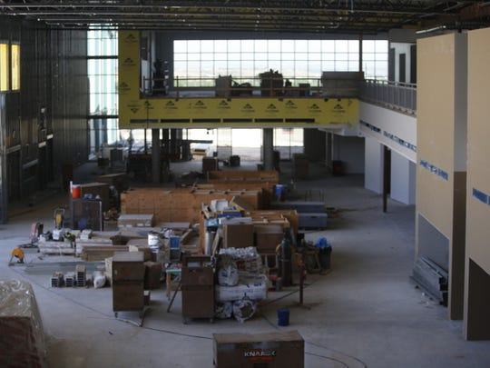 A view of the hall in the new main building at Farmington High School looking east. The first-floor space will serve as the school's commons area and cafeteria, while the second-foot space at the far end will be the school's library.