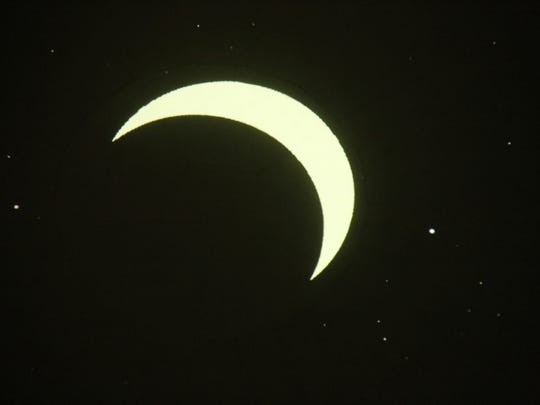A simulation that will be presented Friday at the San Juan College Planetarium of the Aug. 21 solar eclipse as it will look in Farmington shows the moon as it achieves its period of peak coverage of the sun at 11:41 a.m.