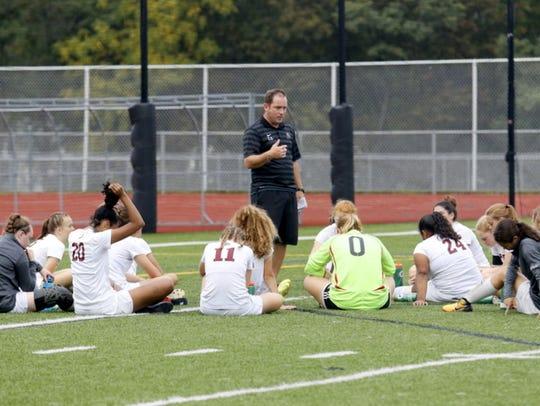 Elmira girls soccer coach Zach Sarno talks to his team