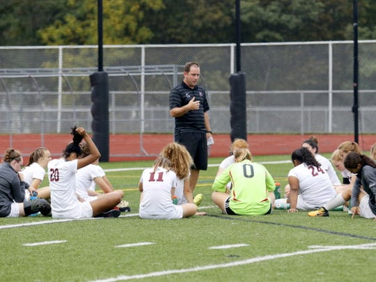 Elmira girls soccer coach Zach Sarno talks to his team at halftime of a win over Johnson City on Sept. 14 at Ernie Davis Academy.