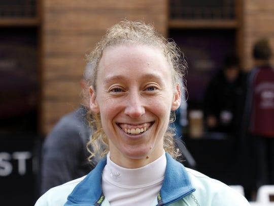 Julianne Quinn of Ithaca won the women's half marathon in 1:16:03.82.