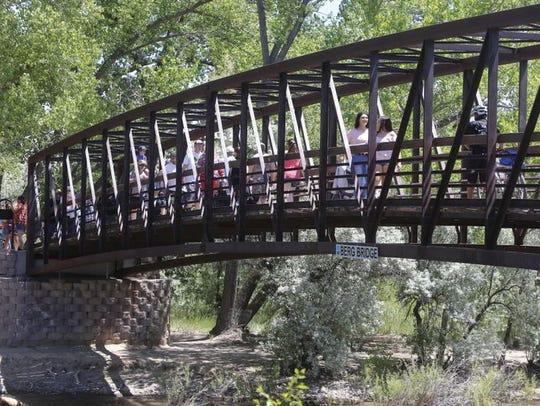 Riverfest visitors cross Berg Bridge over the Animas River during last year's event.