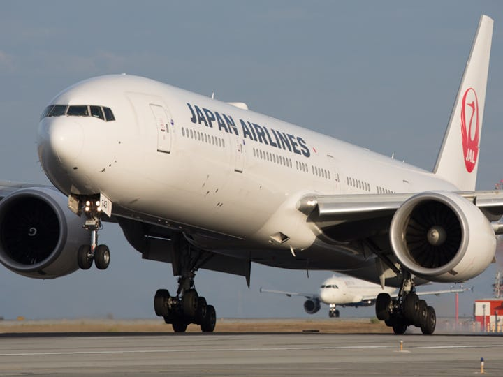 A Japan Airlines Boeing 777 lands from Tokyo at San