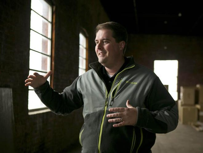 Justin Doyle gives a tour Nov.<133>11 of the Des Moines warehouse Modus Engineering plans to use for its headquarters. <cutline_credit>Rodney White/Register photos</cutline_credit>