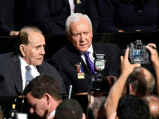 Former Sen. Bob Dole and U.S. Sen. Orrin Hatch, R-Utah, are seen during the evening session of the Republican National Convention at the Quicken Loans arena in Cleveland on July 18, 2016.