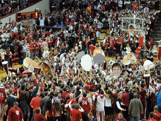 Indiana fans rush the court after knocking off third-ranked Wisconsin 75-72 inside Assembly Hall, Tuesday, January 14, 2014, in Bloomington.