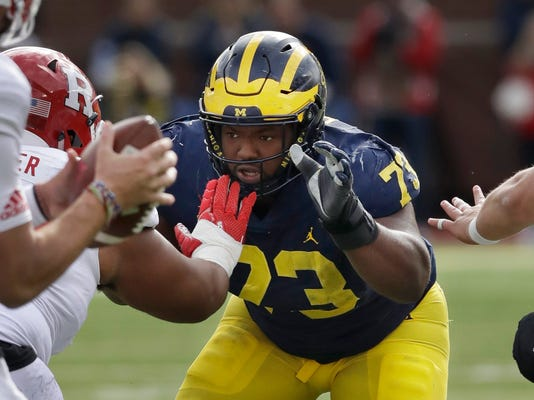 FILE - In this Oct. 28, 2017, file photo, Michigan defensive lineman Maurice Hurst (73) goes up against the Rutgers line during the first half of an NCAA college football game in Ann Arbor, Mich. A person familiar with the situation says Hurst has been given the OK by doctors to participate fully at Michigan's pro day. The person spoke Thursday night, March 22, 2018, to The Associated Press on condition of anonymity because the clearance wasn't announced. Hurst, a potential first-round pick, was held out of drills at the combine three weeks ago after doctors red-flagged a heart condition. (AP Photo/Carlos Osorio, File)