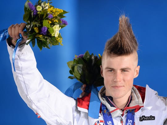 Norway's silver medalist Staale Sandbech celebrates on the podium.