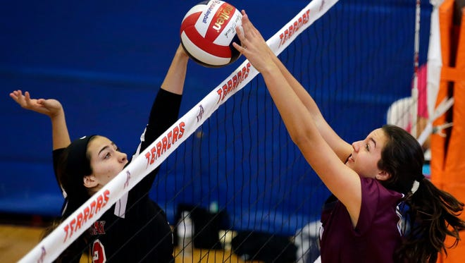 Kamryn Haupt (left) of Green Bay East and Bailey Jacobsen of Fox Valley Lutheran battle at the net during the Terror Varsity Volleyball Invitational Saturday, September 9, 2017, at Appleton West High School in Appleton, Wis.Ron Page/USA TODAY NETWORK-Wisconsin