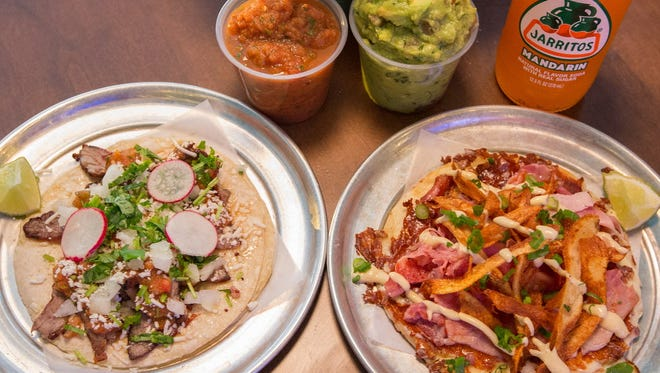 Carna asada (left) and Sen–or Croque tacos (ham, melted cheese, fried potato skins) represent the traditional and creative tacos at Taqueria El Jefe, 11200 W. Burleigh St., Wauwatosa, in the Mayfair Collection.