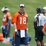 Denver Broncos quarterback Peyton Manning looks on during an NFL football minicamp at the team's headquarters Thursday, June 11, 2015, in Englewood, Colo.